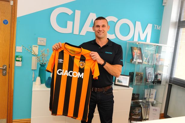 Mike Wardell, CEO of Jiacom, with a sponsored Hull City shirt.