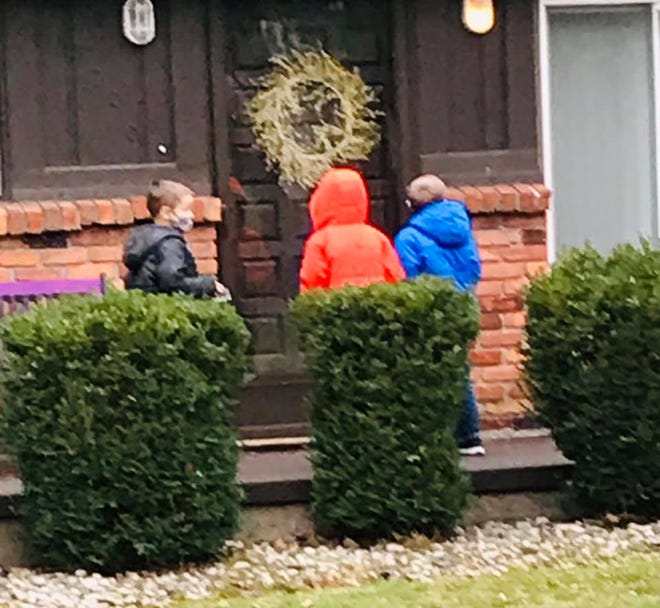 After Thanksgiving on Friday, November 27, 2020, Chelsea Krallman and her three sons helped deliver dozens of cookies to their neighbors.