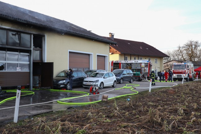 Three firefighters in a major fire at a car workshop in Satellite