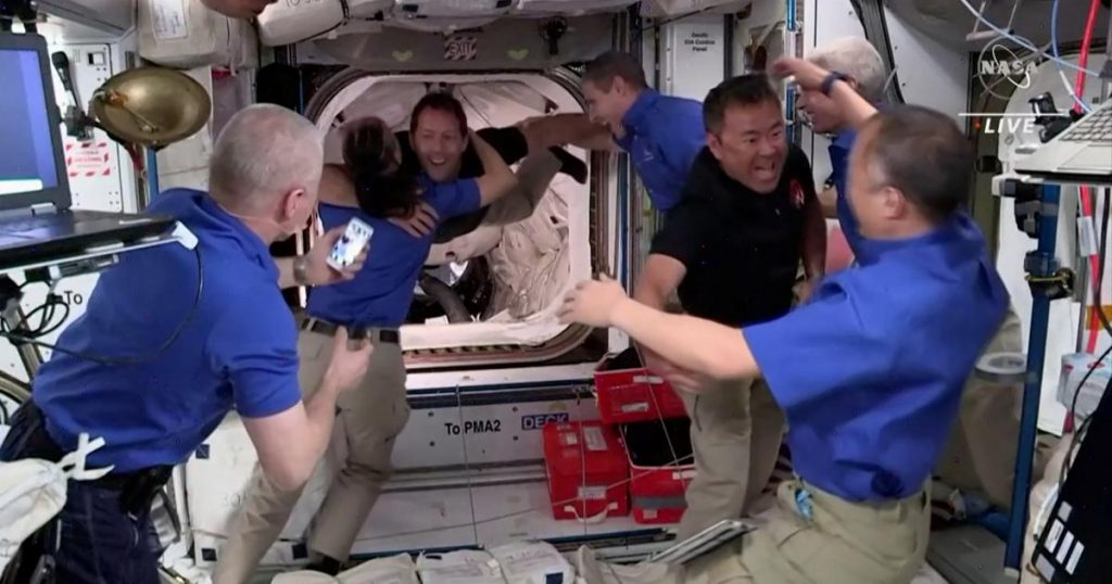 The astronauts in the ISS hug for joy
