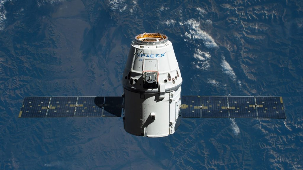 The space capsule crew gets a new parking space at Dragon ISS