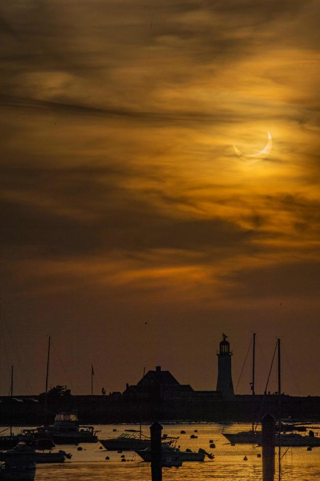 June 10, 2021, partial solar eclipse at the Cichut Lighthouse in Massachusetts, USA.