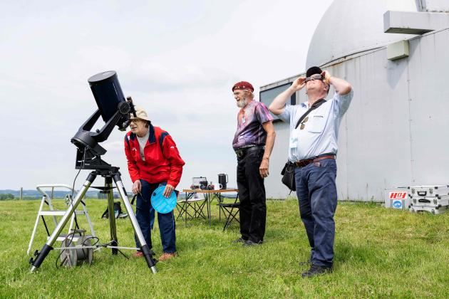 People observe a partial solar eclipse on June 10, 2021 in Dolos, Denmark.