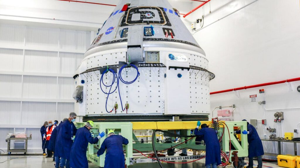 Starliner returns to Boeing space capsule factory and delays test flight by several months