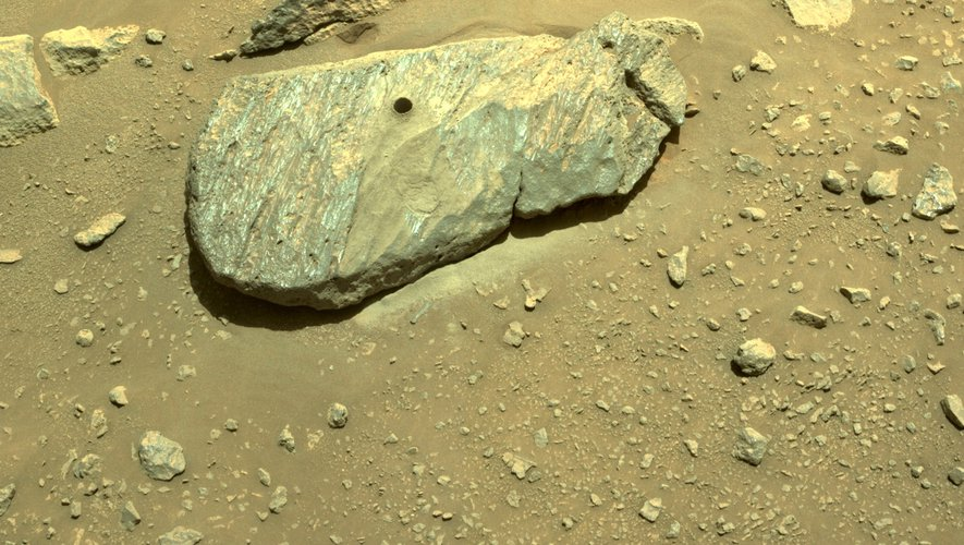 Historical first!  The NASA robot received its first piece of rock from Mars
